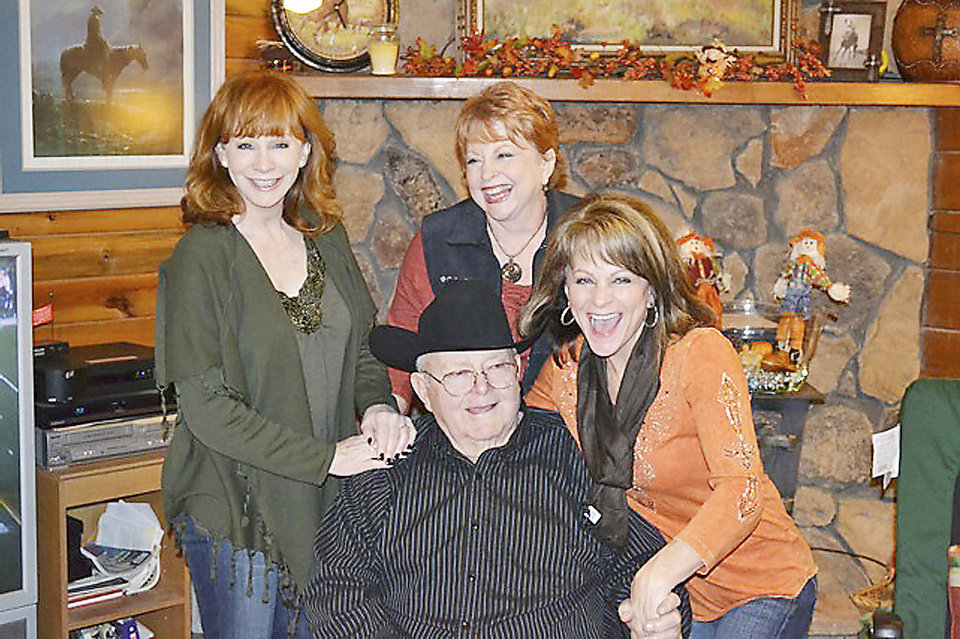 Photo -  From left, Reba McEntire, Alice Foran and Susie McEntire Eaton are shown with their father, Clark McEntire. Clark and Jackie McEntire also have a son, Pake McEntire. Clark McEntire, a three-time world champion steer roper, died late Thursday after a lengthy illness. PHOTO PROVIDED   Photo Provided -