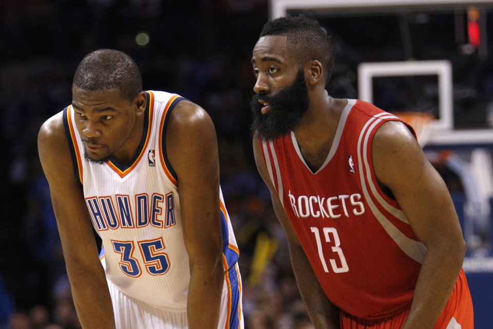 Photo - Oklahoma City's Kevin Durant (35) and Houston's James Harden (13) talks during a free throw during the NBA game between the Oklahoma City Thunder and Houston Rockets at the  Chesapeake Energy Arena  in Oklahoma City, Okla., Tuesday, March 11, 2014. Photo by Sarah Phipps, The Oklahoman