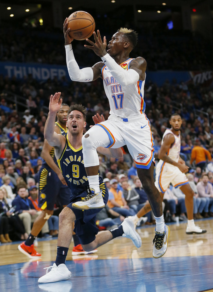 Photo - Oklahoma City's Dennis Schroder (17) takes the ball to the basket in front of Indiana's T.J. McConnell (9) in the second quarter during an NBA basketball game between the Indiana Pacers and the Oklahoma City Thunder at Chesapeake Energy Arena in Oklahoma City, Wednesday, Dec. 4, 2019. [Nate Billings/The Oklahoman]