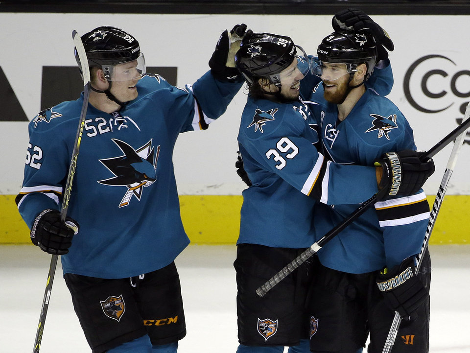 Photo - San Jose Sharks' Martin Havlat, right, of the Czech Republic, celebrates his third goal of the game against the Colorado Avalanche with teammates Logan Couture (39) and Matt Irwin (52) during the third period of an NHL hockey game on Friday, April 11, 2014, in San Jose, Calif. San Jose won 5-1.(AP Photo/Marcio Jose Sanchez)