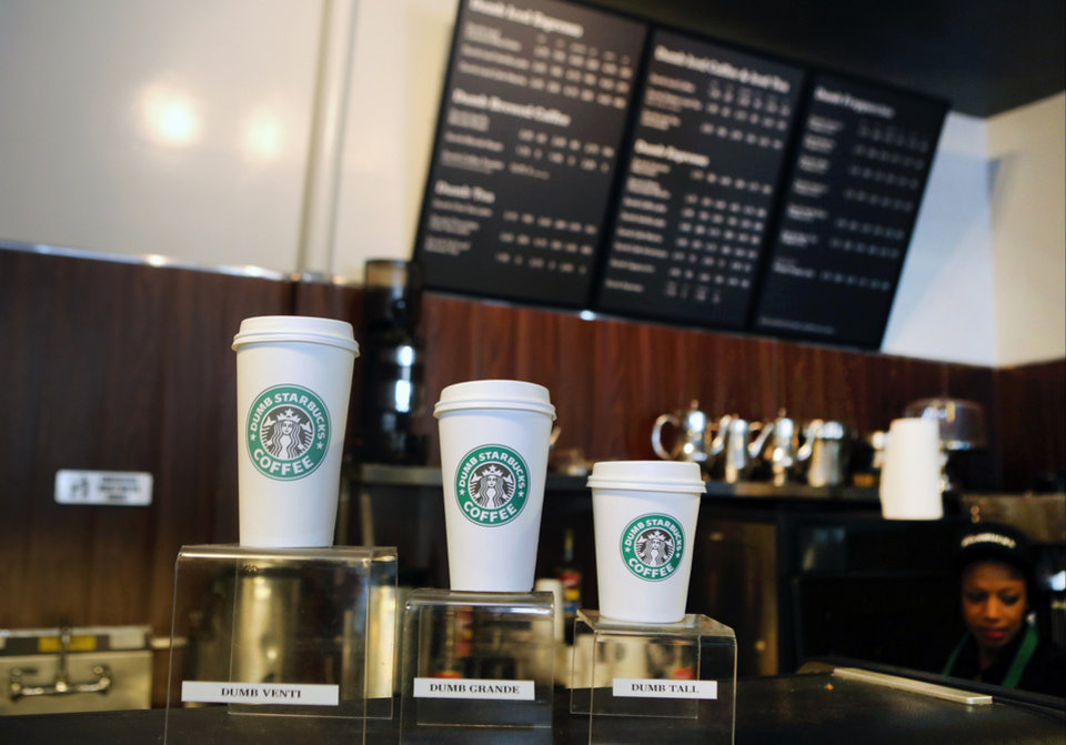 Photo - Featured coffee drinks sizes, Dumb Venti, Dumb Grande, and Dumb Tall are displayed inside the Dumb Starbucks in Los Angeles, Monday, Feb. 10, 2014. The mysterious shop named