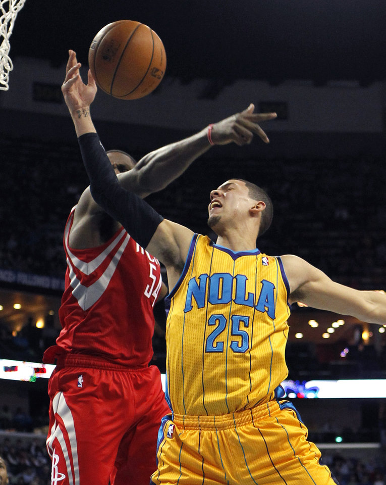 Photo - New Orleans Hornets  guard Austin Rivers (25) drives to the basket against Houston Rockets forward Patrick Patterson (54) in the second half of an NBA basketball game in New Orleans, Friday, Jan. 25, 2013.  The Rockets won 100-82. (AP Photo/Gerald Herbert)