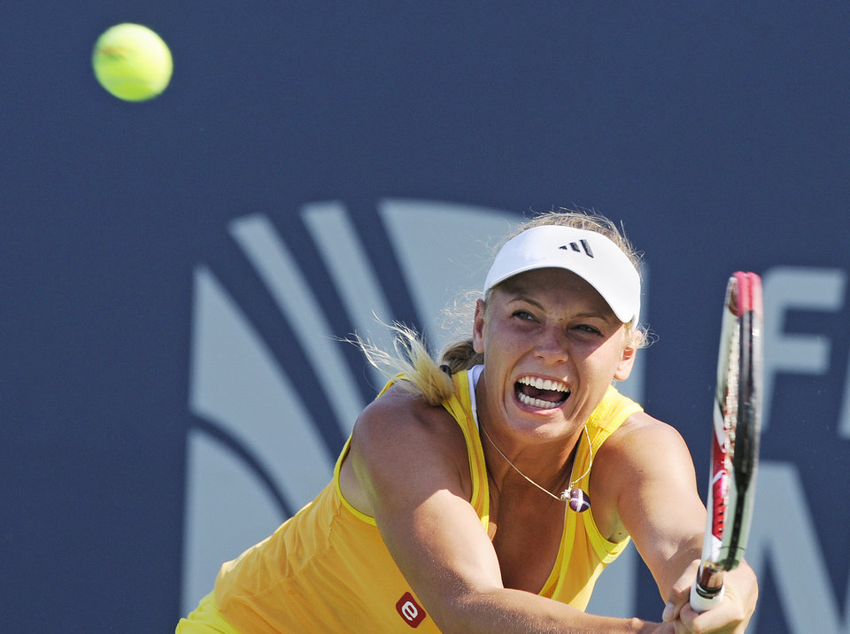 Photo -   Caroline Wozniacki, of Denmark, hits a backhand during her 7-6 (4), 6-2 victory over Sofia Arvidsson, of Sweden, at the New Haven Open tennis tournament in New Haven, Conn., on Wednesday, Aug. 22, 2012. (AP Photo/Fred Beckham)