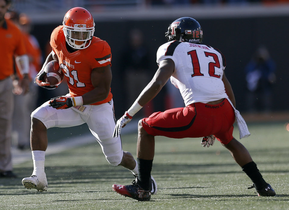 Oklahoma State\'s Jeremy Smith (31) looks to get by Texas Tech\'s D.J. Johnson (12) during a college football game between Oklahoma State University and the Texas Tech University (TTU) at Boone Pickens Stadium in Stillwater, Okla., Saturday, Nov. 17, 2012. Photo by Sarah Phipps, The Oklahoman