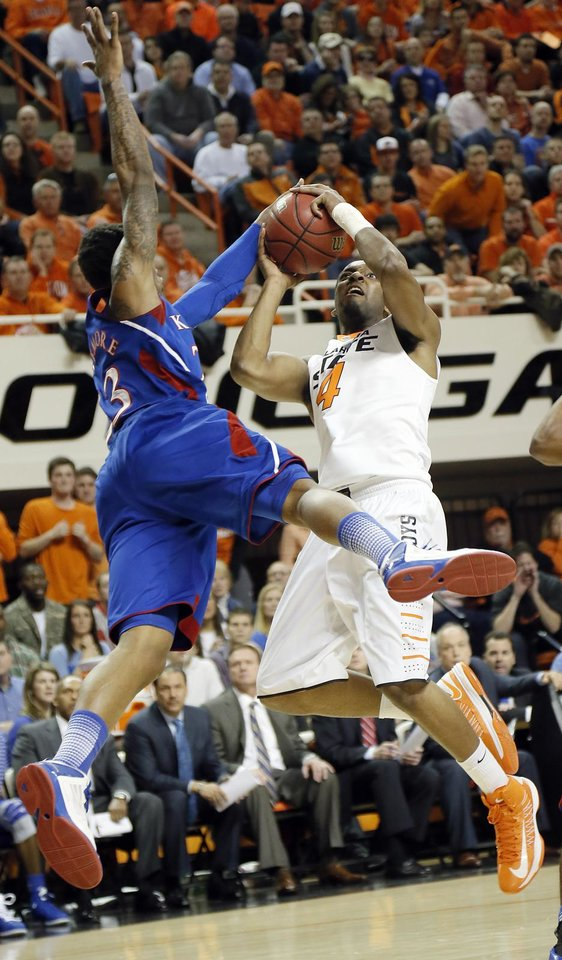 Photo - Kansas' Ben McLemore (23) defends Oklahoma State 's Brian Williams (4) during the college basketball game between the Oklahoma State University Cowboys (OSU) and the University of Kanas Jayhawks (KU) at Gallagher-Iba Arena on Wednesday, Feb. 20, 2013, in Stillwater, Okla. Photo by Chris Landsberger, The Oklahoman