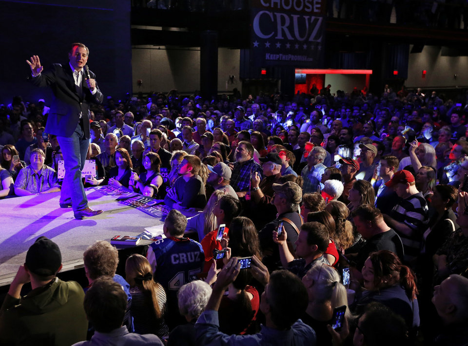 Photo -  Republican presidential candidate Ted Cruz speaks Sunday at the Chevy Bricktown Events Center as part of a rally in Oklahoma City. [Photo by Steve Sisney, The Oklahoman]