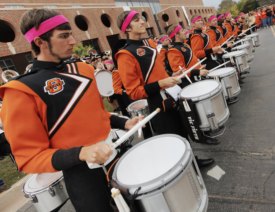The drummers from the OSU Cowboy Marching Band play at the start of the Spirit Walk before the college football game between the Oklahoma State Cowboys (OSU) and the Nebraska Huskers (NU) at Boone Pickens Stadium in Stillwater, Okla., Saturday, Oct. 23, 2010. Photo by Nate Billings, The Oklahoman