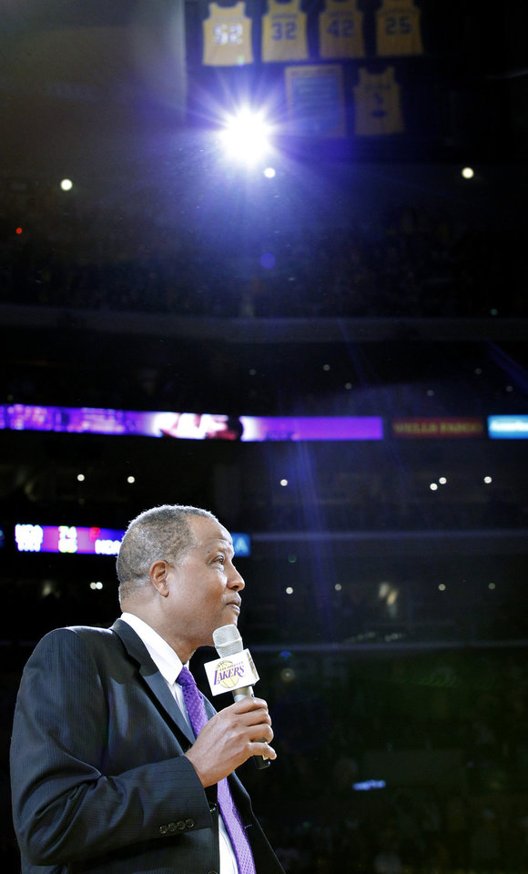 Photo - Former Los Angeles Laker Jamaal Wilkes speaks during a ceremony to retire his No. 52 jersey, above, at halftime of an NBA basketball game between the Lakers and the Portland Trail Blazers, Friday, Dec. 28, 2012, in Los Angeles. (AP Photo/Alex Gallardo)