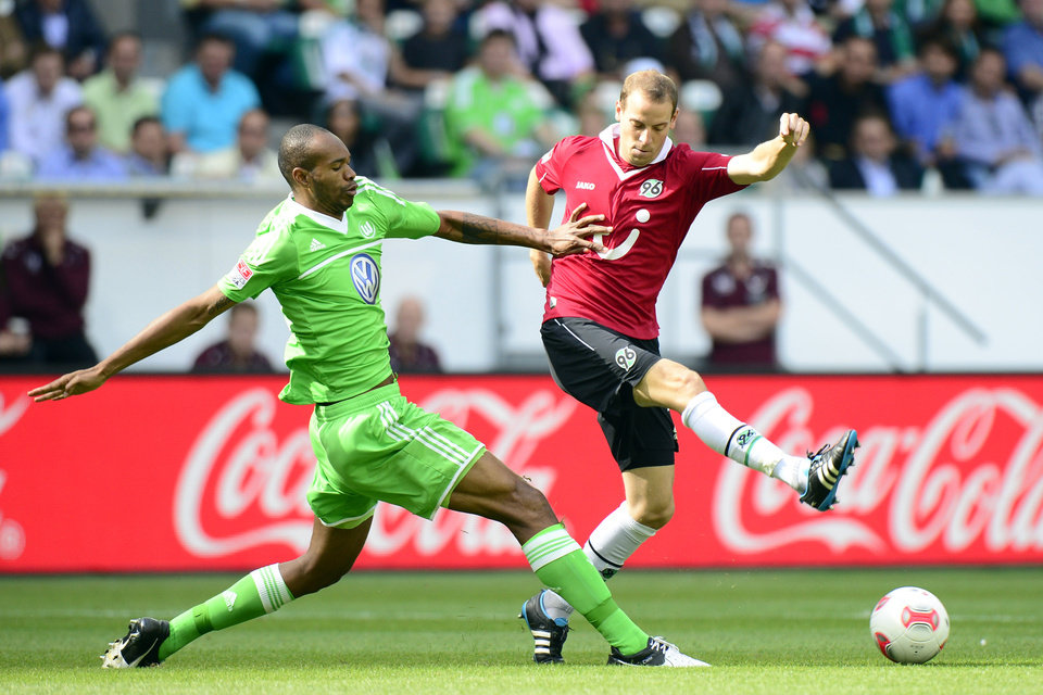 Photo -   Wolfsburg's Naldo, left, and Hannover's Jan Schlaudraff challenge for the ball during the German first division Bundesliga soccer match between VfL Wolfsburg and Hannover 96 in Wolfsburg, Germany, Sunday, Sept. 2, 2012. (AP Photo/dapd, Nigel Treblin) - NO MOBILE USE UNTIL 2 HOURS AFTER THE MATCH, WEBSITE USERS ARE OBLIGED TO COMPLY WITH DFL-RESTRICTIONS, SEE INSTRUCTIONS FOR DETAILS -