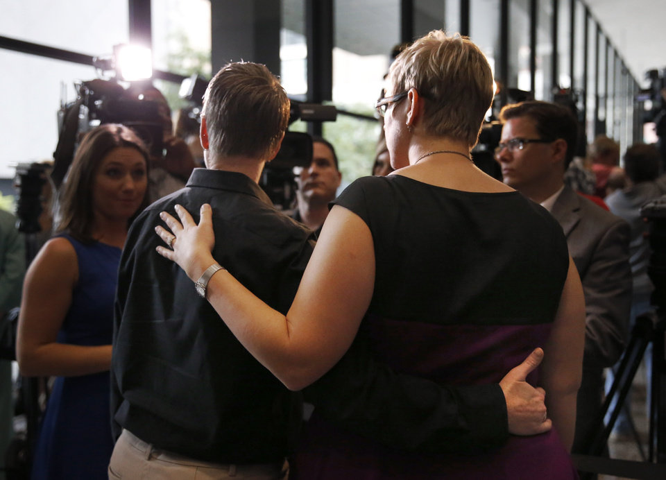 Photo - Tara Betterman-Layne, left, and her wife Melody Betterman-Layne, both from Indianapolis, Ind., talk to reporters after attending a hearing before the 7th U.S. Circuit Court of Appeals on the challenges to Indiana and Wisconsin's gay marriage ban Tuesday, Aug. 26, 2014, in Chicago. (AP Photo/Charles Rex Arbogast)