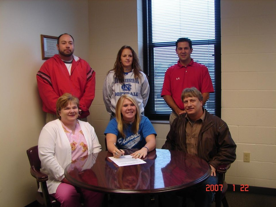 Courtney Jones, Washington High School senior, signed to play softball with North Central Texas College in Gainsville, Texas, on January 23, 2007. Pictured seated (l-r) mother, Melody Walker, Courtney Jones, father, Barry Jones; standing (l-r) WHS Coach David Vallerand, NCTC Assistant Coach Taylor Christian, and WHS Coach Mike Lawless. Community Photo By: LuGlena Moore Submitted By: LuGlena, Washington