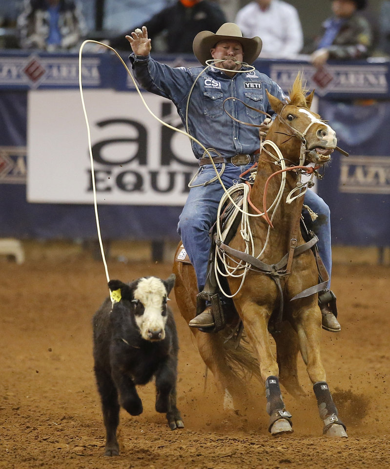 Photo - Kyle Lockett of Visalia, California,  competes in the tie-down roping event during the Timed Event Championship inside the Lazy E Arena in Guthrie, Okla., Friday, March 13, 2020. [Bryan Terry/The Oklahoman]