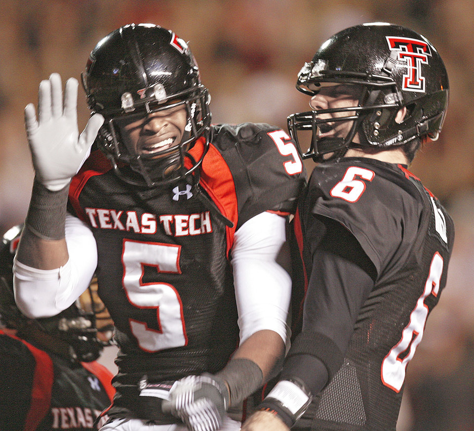 Photo - Stopping Texas Tech wide receiver Michael Crabtree, left, and quarterback Graham Harrell will be a top priority for the OU defense. Photo by Chris Landsberger, The Oklahoman