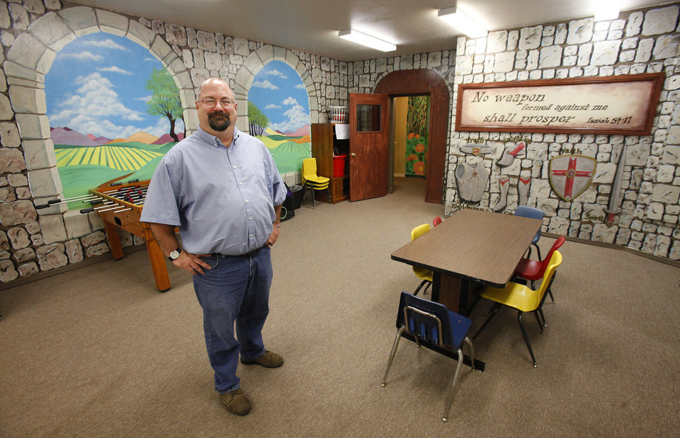 Photo - The Rev. Chris Muse, senior pastor of Nicoma Park Christian Church (Disciples of Christ), stands inside the children's room at the church's new building at 1701 N Westminster in Nicoma Park.  David McDaniel - The Oklahoman