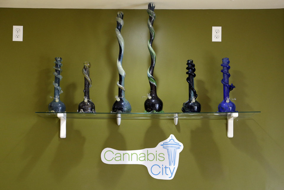 Photo - Glass pipes line a shelf at the Cannabis City marijuana shop days before the grand opening Wednesday, July 2, 2014, in Seattle. Pot is expected to be available for sale at the store beginning Tuesday, July 8, the first day that recreational marijuana can legally be sold in Washington state and the store is expected to be the first licensed retailer in Seattle. (AP Photo/Elaine Thompson)
