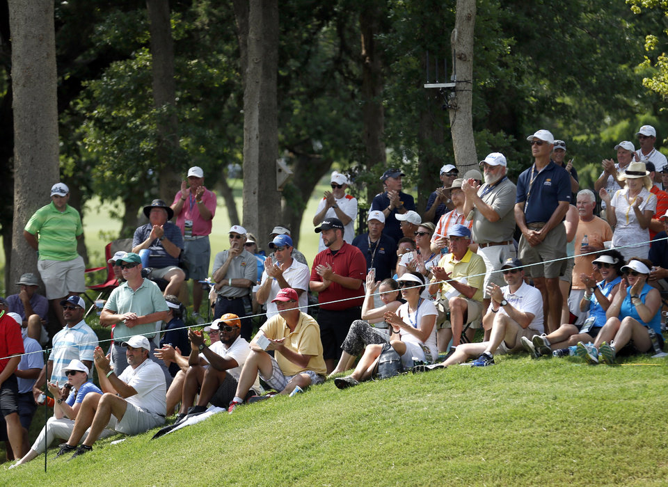 Photo - Fans cheer on the 4th hole during the U.S. Senior Open golf tournament at Oak Tree National in Edmond, Okla., Thursday, July 10, 2014. Photo by Sarah Phipps, The Oklahoman