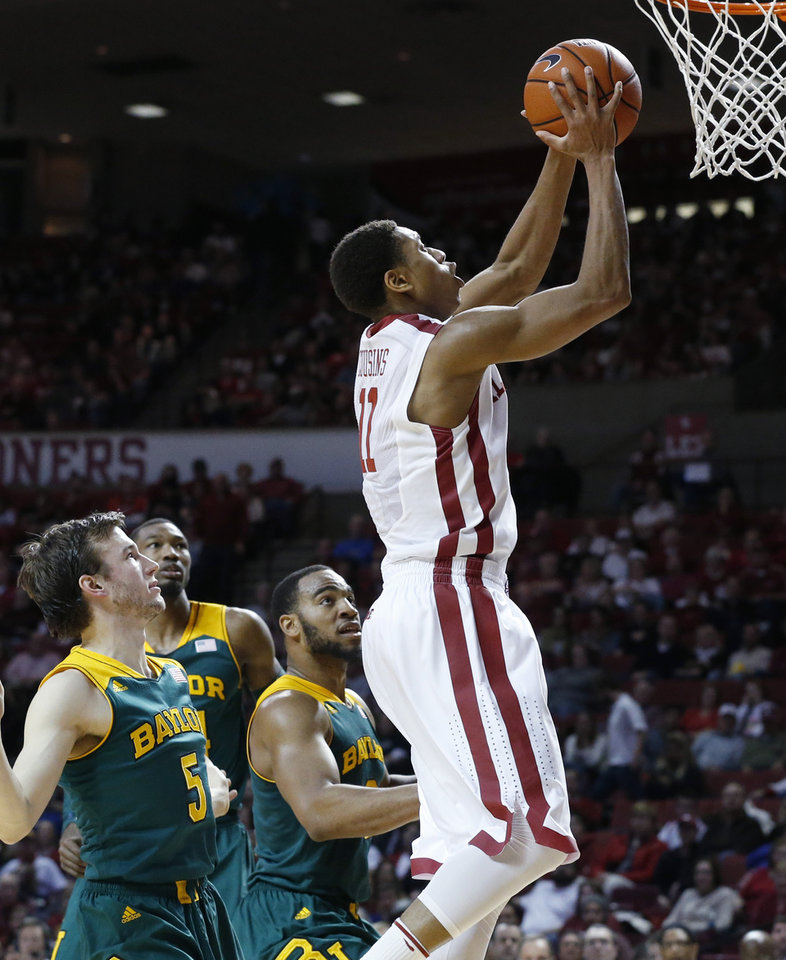 Photo - Oklahoma guard Isaiah Cousins (11) shoots in front of Baylor guard Brady Heslip (5), forward Cory Jefferson, back left, and forward Rico Gathers (2) in the second half of an NCAA college basketball game in Norman, Okla., Saturday, Feb. 8, 2014. Oklahoma won 88-72. (AP Photo/Sue Ogrocki)