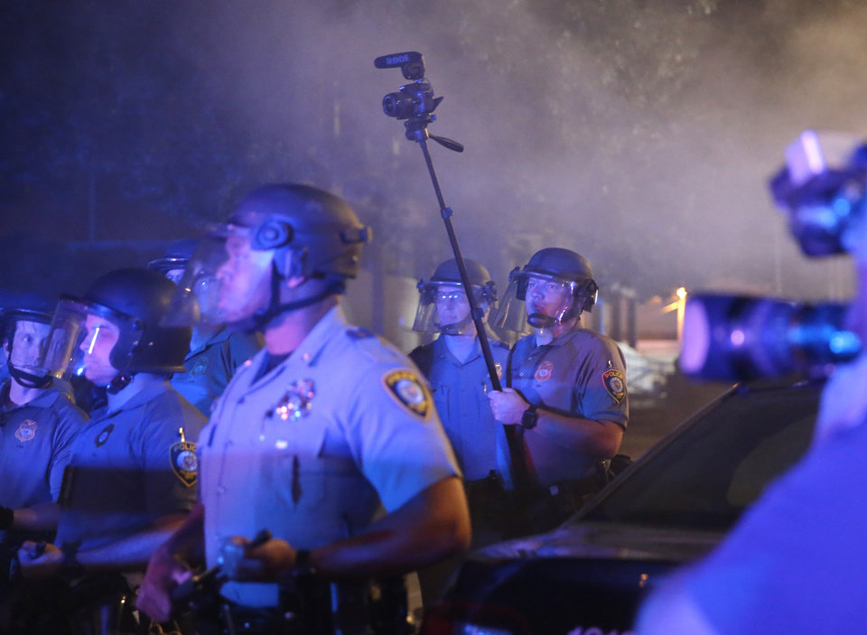 Photo - Oklahoma City Police films protestors in front of the station in Oklahoma City, Saturday, May 30, 2020. The protest was in response to the death of George Floyd. [Sarah Phipps/The Oklahoman]