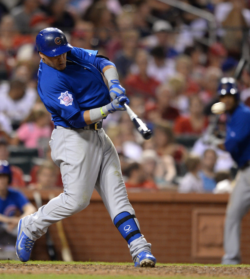 Photo - Chicago Cubs' Javier Baez hits a two-run double against the St. Louis Cardinals in the eighth inning in a baseball game, Friday, Aug. 29, 2014, at Busch Stadium in St. Louis. (AP Photo/Bill Boyce)