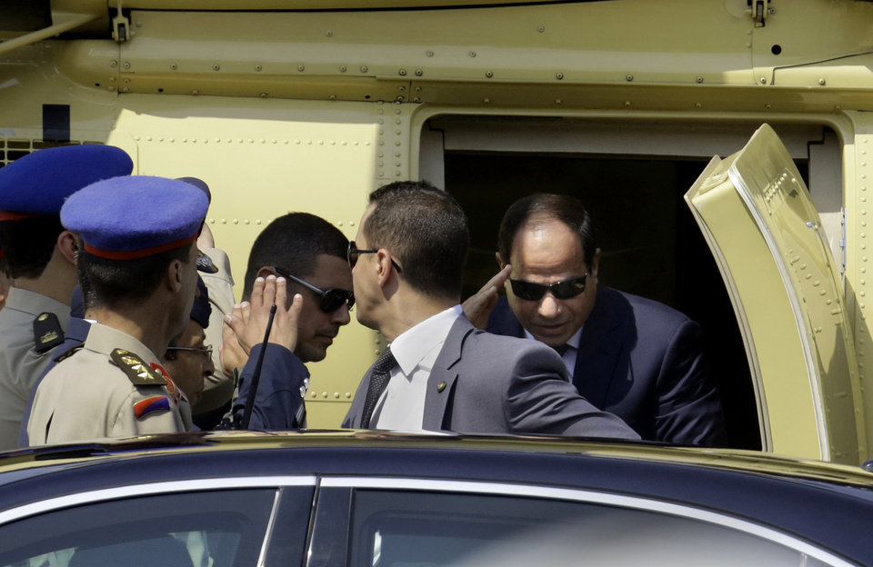 Photo - Egyptian President-elect Abdel-Fattah el-Sissi gets out of a military helicopter as he arrives at the Supreme Constitutional Court, to take the oath of office in Cairo, Egypt, Sunday, June 8, 2014. Egypt's former army chief El-Sissi was sworn in on Sunday as president for a four-year term, taking the reins of power in a nation roiled since 2011 by deadly unrest and economic woes. (AP Photo/Amr Nabil)
