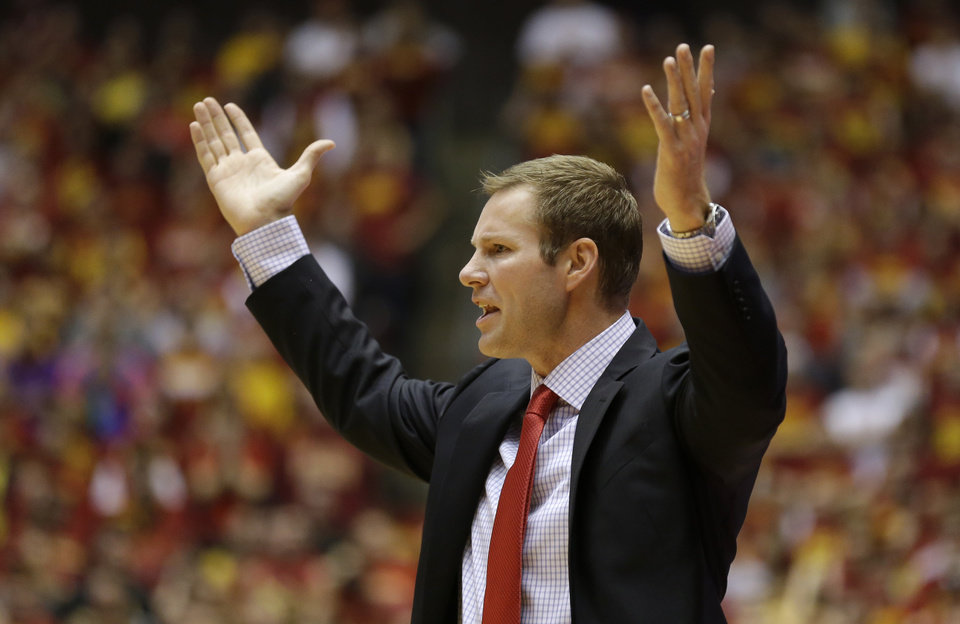 Photo - Iowa State head coach Fred Hoiberg reacts to a call during the first half of an NCAA college basketball game against Michigan, Sunday, Nov. 17, 2013, in Ames, Iowa. (AP Photo/Charlie Neibergall)
