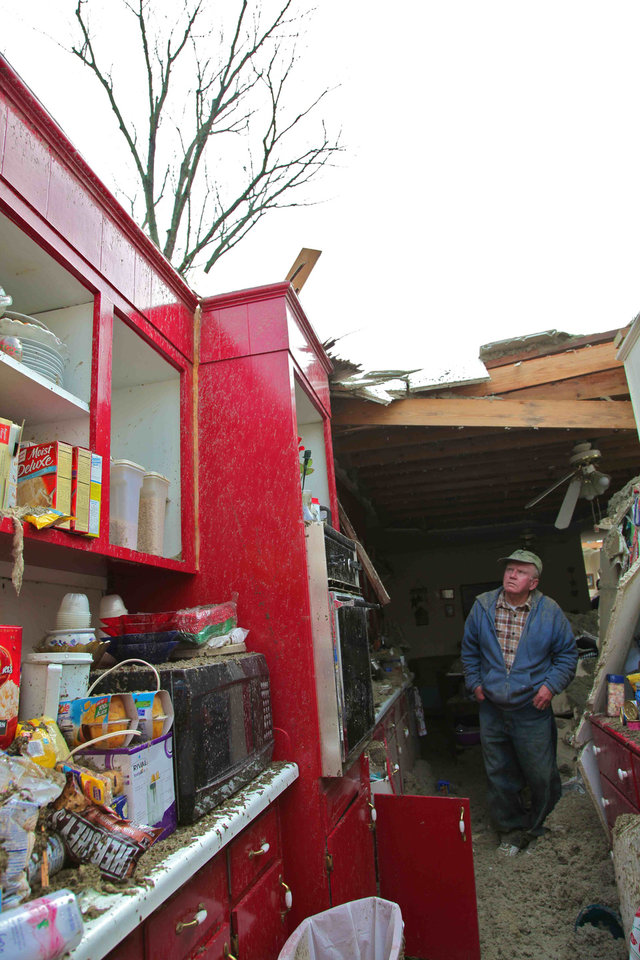 Blaine Lawson, 76, stands inside his house after a reported tornado tore the roof off his home, Friday, March 2, 2012, in Cleveland, Tenn. Neither he nor his wife were injured. (AP Photo/Robert Ray) ORG XMIT: TNRR103