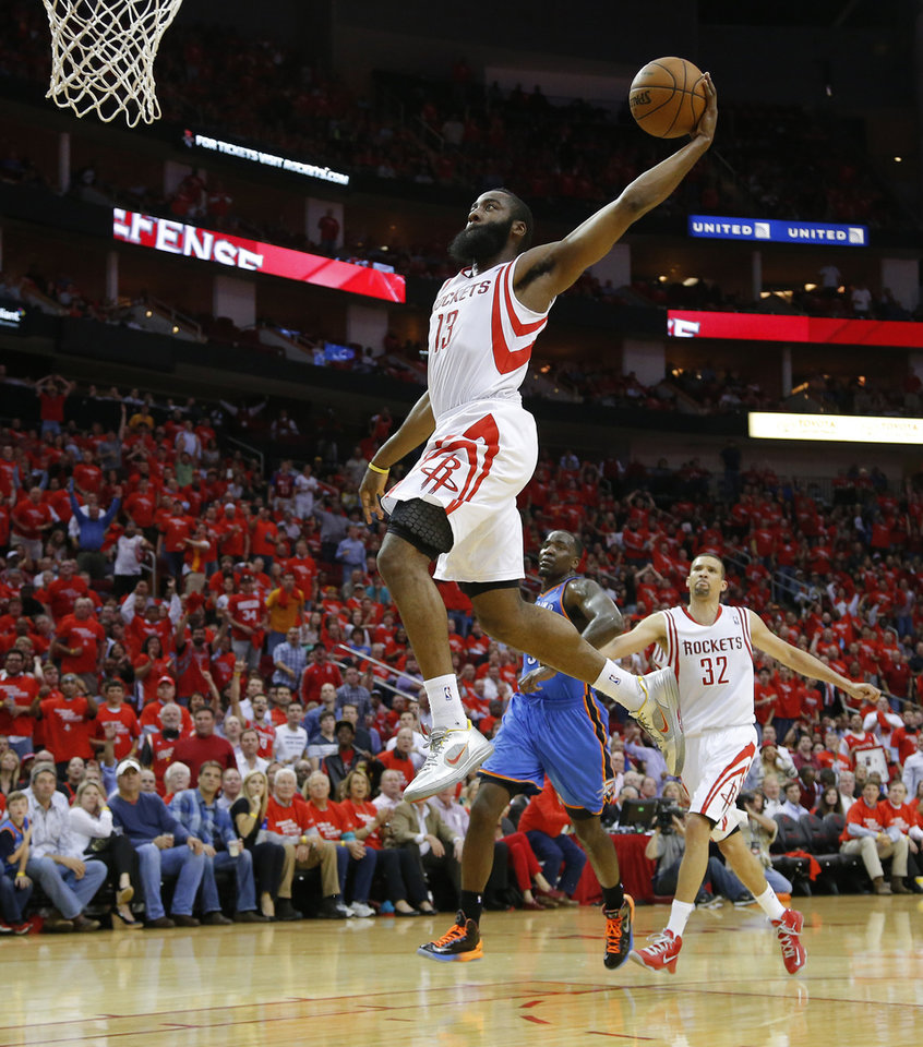 Photo - Houston's James Harden (13) goes up for a dunk as Oklahoma City's Kendrick Perkins (5) and Houston's Francisco Garcia (32) watch during Game 4 in the first round of the NBA playoffs between the Oklahoma City Thunder and the Houston Rockets at the Toyota Center in Houston, Texas,Sunday, April 29, 2013. Oklahoma City lost 105-103. Photo by Bryan Terry, The Oklahoman
