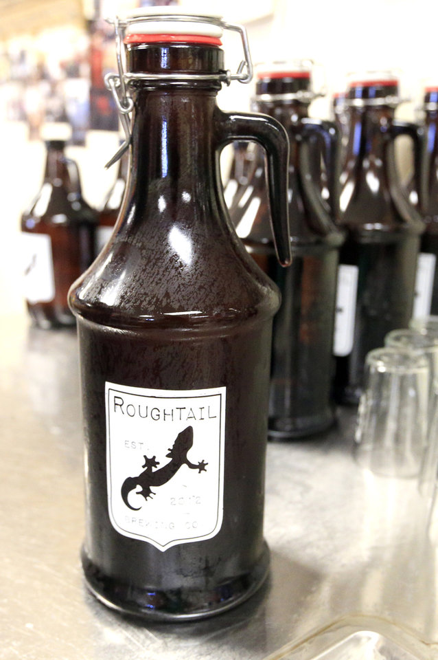 Photo -  A two-liter growler is pictured at Roughtail Brewing Co. in Midwest City. The brewery offers three sizes of glass bottles that can be filled with a new low-point beer. Photo by Sarah Phipps, The Oklahoman   SARAH PHIPPS -  SARAH PHIPPS