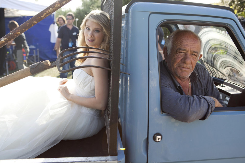 Photo -   In this photo released Wednesday, May 9, 2012 by Bell Phillip Television Productions Inc., Kim Matula, left, who plays Hope, sits on a small truck during the shooting of TV soap opera