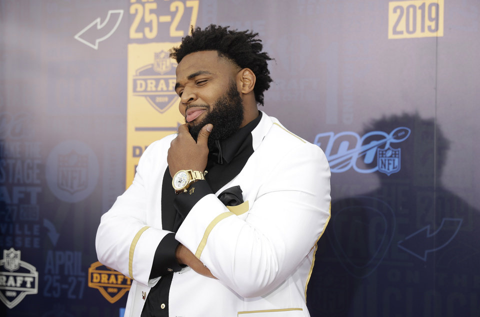Photo - Clemson defensive tackle Christian Wilkins walks the red carpet ahead of the first round at the NFL football draft, Thursday, April 25, 2019, in Nashville, Tenn. (AP Photo/Mark Humphrey)