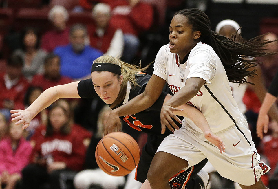 Photo - Stanford's Lili Thompson, right, and Oregon State's Ali Gibson chase a loose ball during the second half of an NCAA college basketball game Sunday, Jan. 5, 2014, in Stanford, Calif. (AP Photo/Ben Margot)