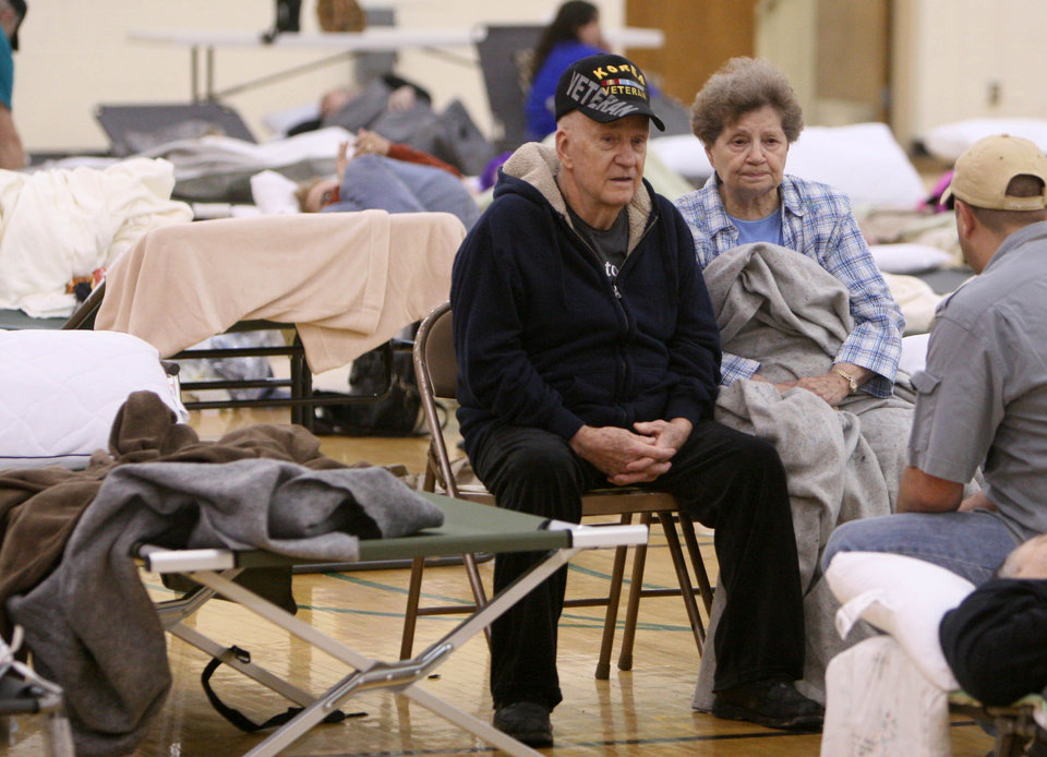 Photo - Donald and Helen Capps of Joplin, Mo., sit in a temporary Red Cross shelter at the Robert Ellis Young Gymnasium at Missouri Southern State University in Joplin, Mo., Monday, May 23, 2011. The Capps lost their home after a destructive tornado moved through Joplin on Sunday evening, killing at least 89 people and injuring hundreds more. (AP Photo/Mark Schiefelbein) ORG XMIT: MOMS101