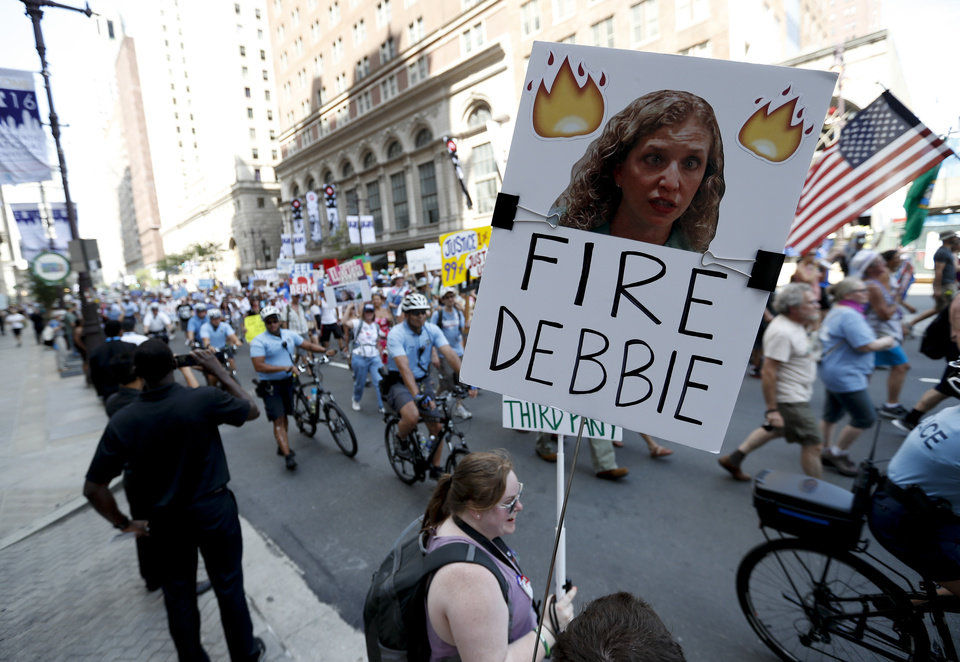 Photo - A supporters of Sen. Bernie Sanders, I-Vt., holds up a sign call calling for Debbie Wasserman Schultz, chairwoman of the Democratic National Committee to be fired, Sunday, July 24, 2016, in Philadelphia. The Democratic National Convention starts Monday. (AP Photo/Alex Brandon)