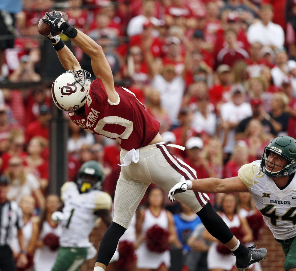 Photo - Oklahoma's Grant Calcaterra (80) catches a touchdown pass as Baylor's Clay Johnston (44) defends in the first quarter during a college football game between the University of Oklahoma Sooners (OU) and Baylor Bears at Gaylord Family-Oklahoma Memorial Stadium in Norman, Okla., Saturday, Sept. 29, 2018. Photo by Nate Billings, The Oklahoman