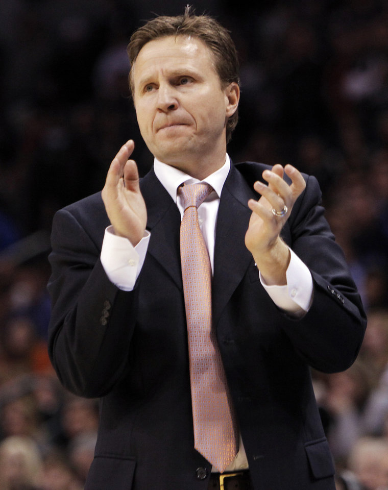 Photo - Thunder head coach Scott Brooks claps his hands in the bench area during the NBA basketball game between the Oklahoma City Thunder and the Utah Jazz at the Ford Center in Oklahoma City, Thursday, December 31, 2009. The Thunder won, 87-86. Photo by Nate Billings, The Oklahoman ORG XMIT: KOD