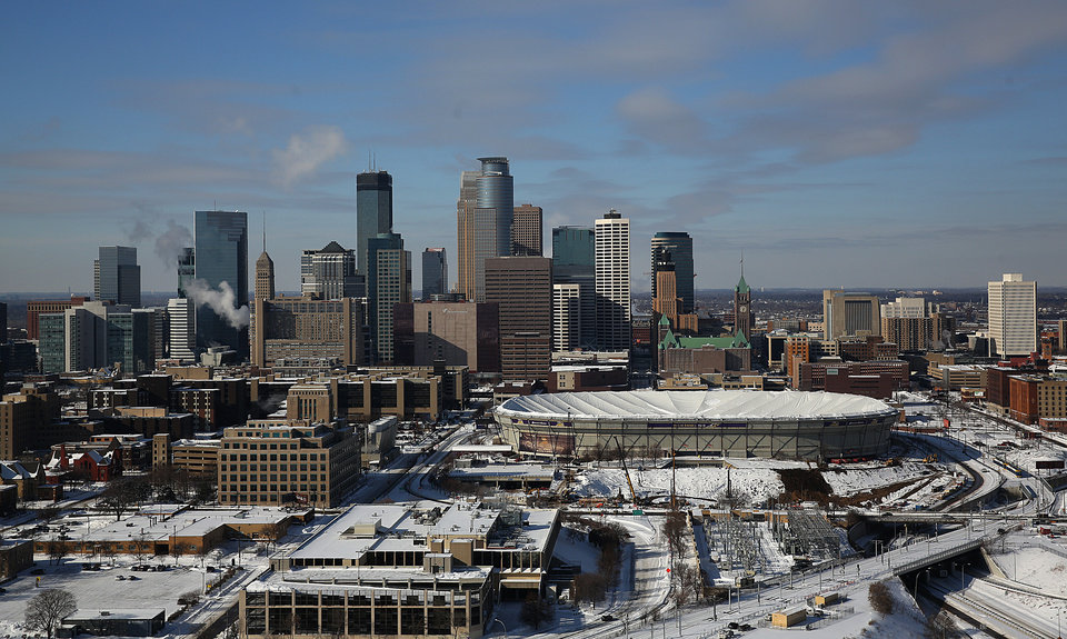 Photo - The roof of the Minnesota Vikings' Metrodome is deflated Saturday, Jan. 18, 2014 in downtown Minneapolis. The 10 acres of Teflon-coated fabric were done deflating in 35 minutes. The deflation and the demolition of the Dome beginning next week will make way for construction of a new $1 billion Vikings stadium. (AP Photo/The Star Tribune, Jim Gehrz)  MANDATORY CREDIT; ST. PAUL PIONEER PRESS OUT; MAGS OUT; TWIN CITIES TV OUT