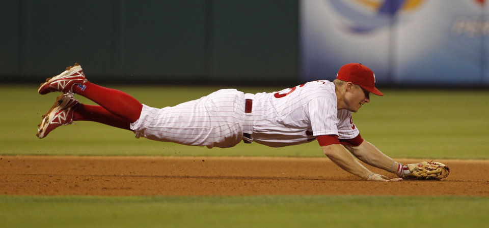 Photo - Philadelphia Phillies' Cody Asche makes catch on San Francisco Giants' Buster Posey's hit in the fifth inning of a baseball game on Tuesday, July 22, 2014, in Philadelphia. (AP Photo/The Philadelphia Inquirer, Ron Cortes)