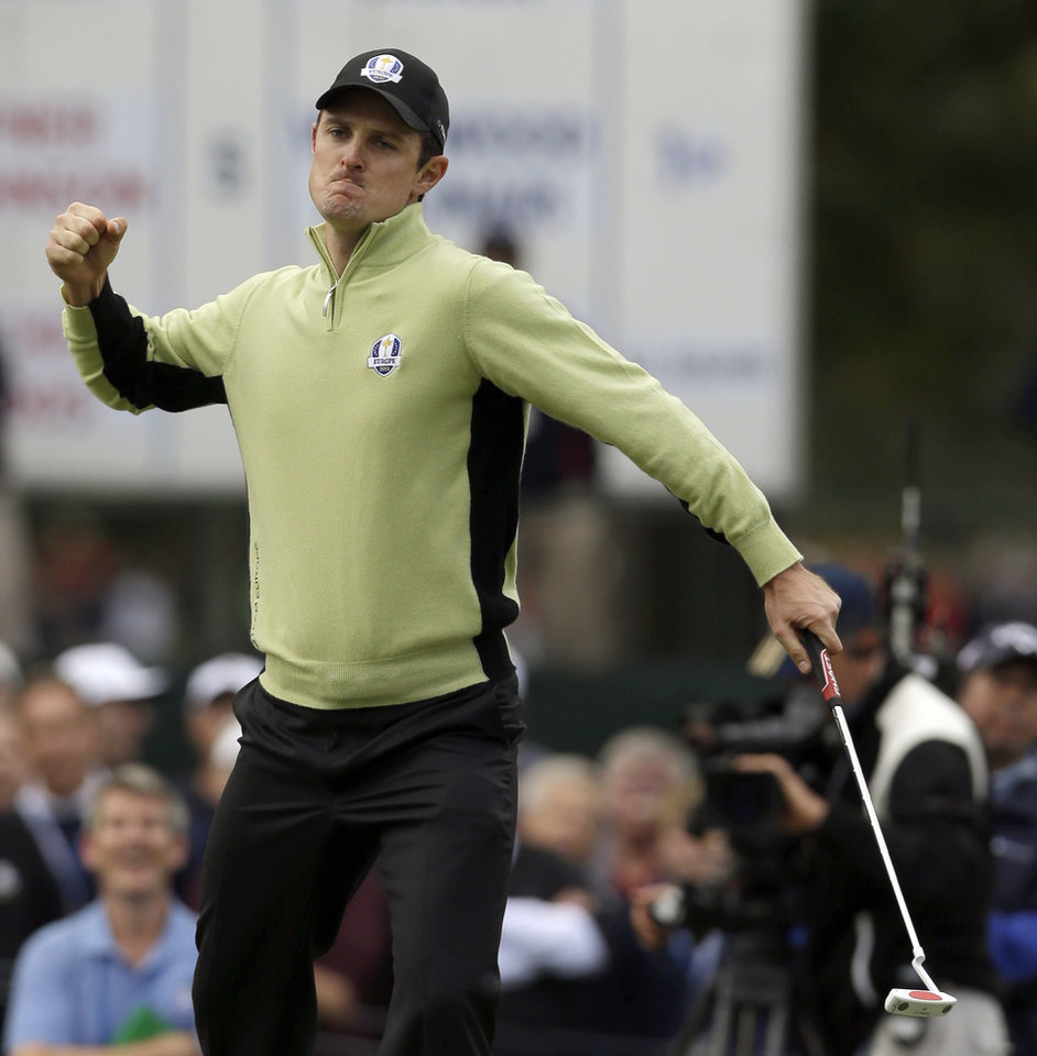 Photo -   Europe's Justin Rose reacts after making a putt on the fourth hole during a foursomes match at the Ryder Cup PGA golf tournament Friday, Sept. 28, 2012, at the Medinah Country Club in Medinah, Ill. (AP Photo/Chris Carlson)