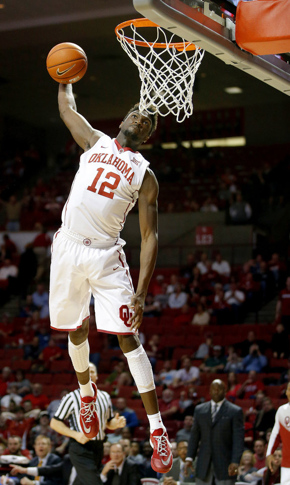 Photo -                    OU's Khadeem Lattin throws down a dunk during the Sooners' 81-36 win over Texas Tech at the Lloyd Noble Center on Wednesday.                     Photo by Bryan Terry                                                         The Oklahoman