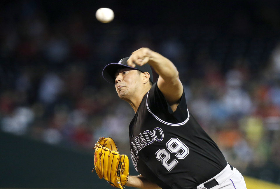 Photo - Colorado Rockies' Jorge De La Rosa throws a pitch against the Arizona Diamondbacks during the first inning of a baseball game Sunday, Aug. 31, 2014, in Phoenix. (AP Photo/Ross D. Franklin)