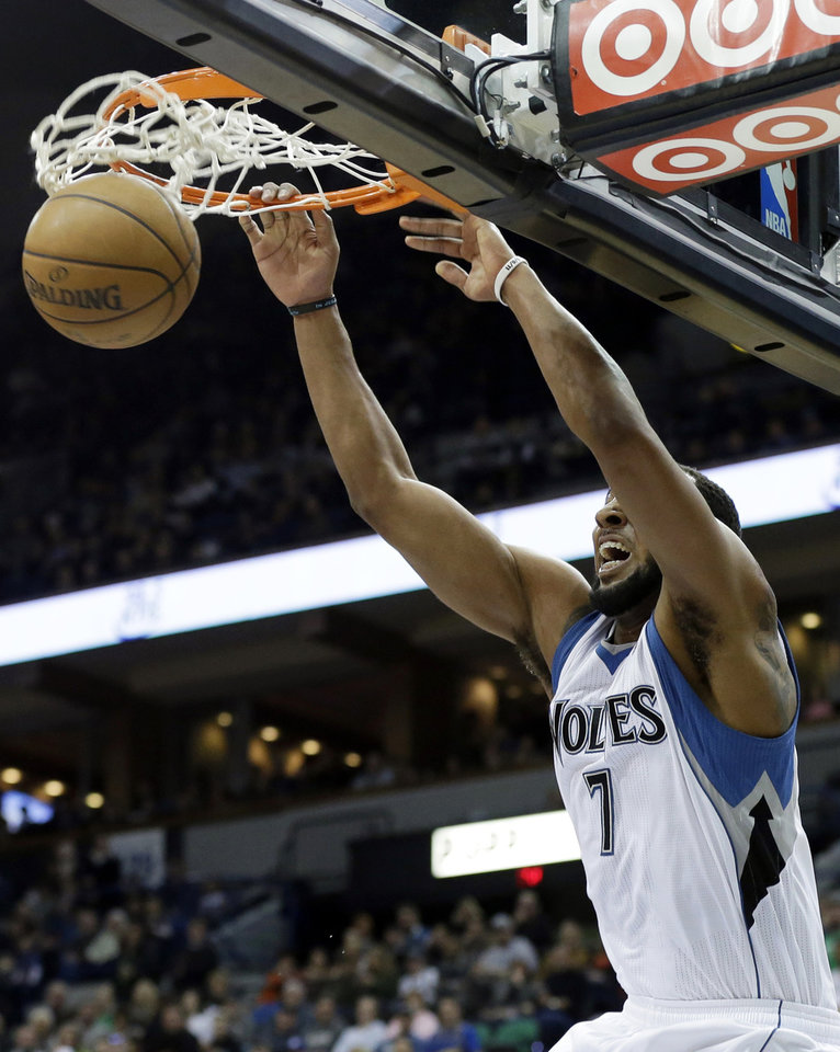 Minnesota Timberwolves' Derrick Williams slams in the first quarter of an NBA basketball game against the Golden State Warriors Sunday, Feb. 24, 2013, in Minneapolis. (AP Photo/Jim Mone)