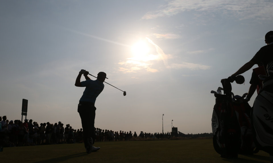 Photo - Dustin Johnson of the US plays a shot off the 17th tee during the second day of the British Open Golf championship at the Royal Liverpool golf club, Hoylake, England, Friday July 18, 2014. (AP Photo/Peter Morrison)