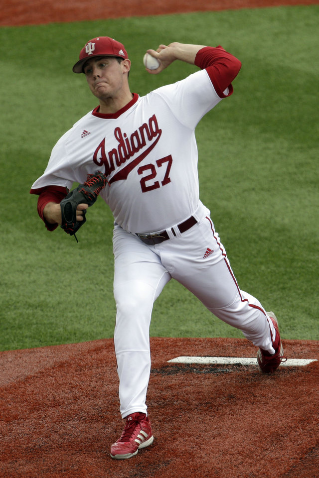 Photo - Indiana pitcher Brian Korte throws in the first inning against Stanford during an NCAA college baseball regional tournament game in Bloomington, Ind.,  Monday, June 2, 2014. (AP Photo/AJ Mast)