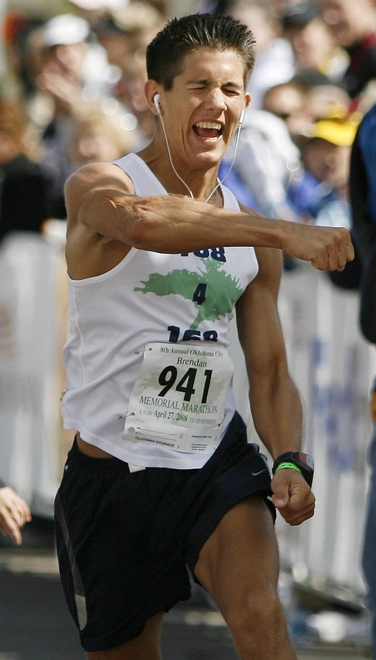 Brendan Brustad finishes the Oklahoma City Memorial Marathon, Sunday, April 27, 2008. Brustad ran a total 168 miles including the marathon to honor those killed in the Oklahoma City bombing. BY BRYAN TERRY, THE OKLAHOMAN