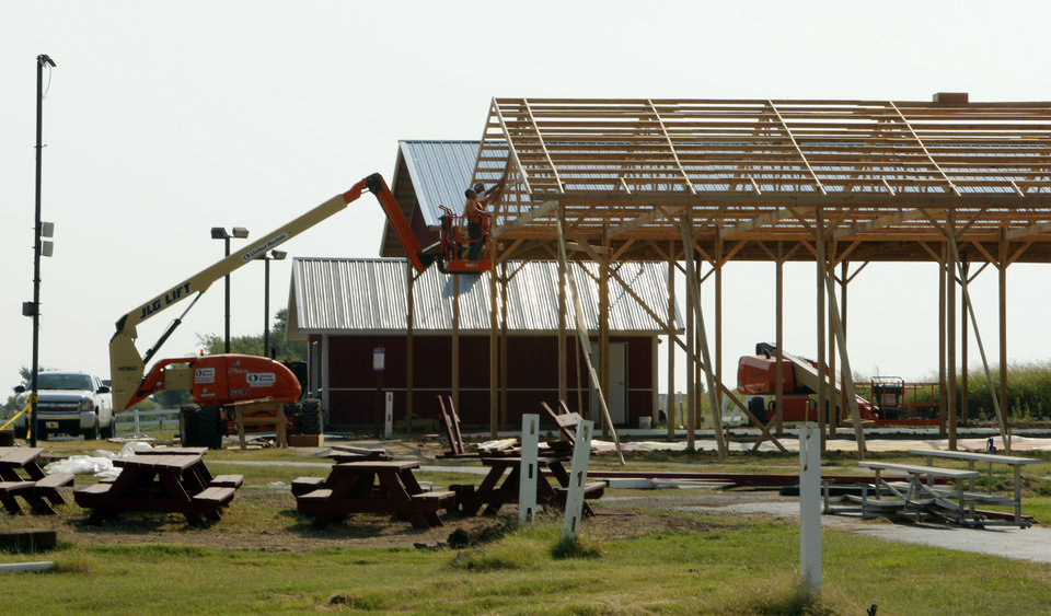 Photo - Workers put up a new structure at Orr Family Farms on Thursday, Sept. 12, 2013 in Oklahoma City, Okla.  Photo by Steve Sisney, The Oklahoman