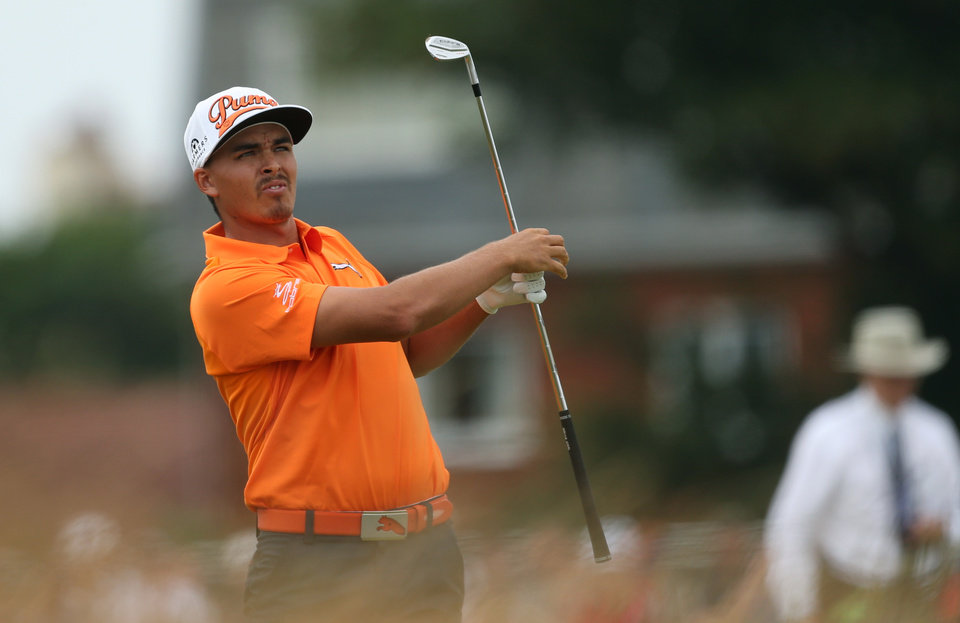 Photo - Rickie Fowler of the US watches his shot from the rough on the 1st fairway during the final round of the British Open Golf championship at the Royal Liverpool golf club, Hoylake, England, Sunday July 20, 2014. (AP Photo/Peter Morrison)