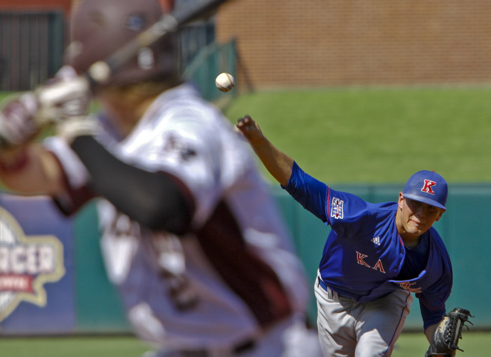 Photo - Kansas' Frank Duncan (19) throws a pitch during the Big 12 baseball tournament game between Texas A&M University and the University of Kansas at the Chickasaw Bricktown Ballparkon Wednesday, May 23, 2012, in Oklahoma City, Oklahoma. Photo by Chris Landsberger, The Oklahoman