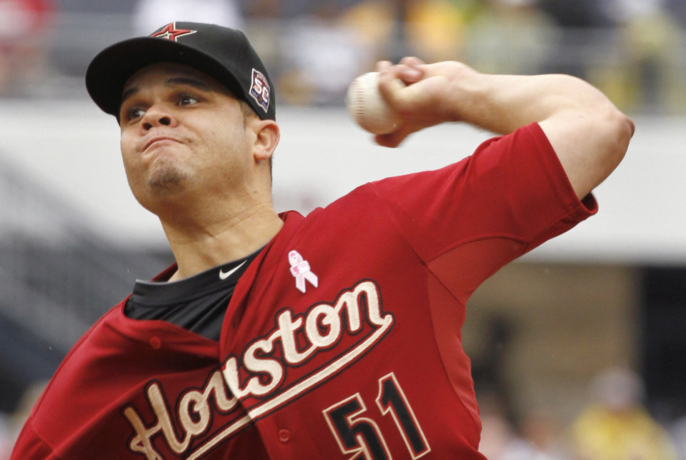 Photo -   Houston Astros starting pitcher Wandy Rodriguez throws against the Pittsburgh Pirates in the first inning of a baseball game on Sunday, May 13, 2012, in Pittsburgh. (AP Photo/Keith Srakocic)