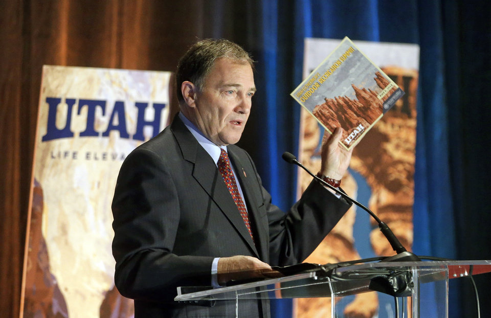 Utah Gov. Gary Herbert addresses the annual Outdoor Recreation Summit Thursday, May 8, 2014, in Salt Lake City. Gov. Herbert has kicked off his first annual Outdoor Recreation Summit by signing a long-awaited swap of state and federal lands in Grand, San Juan and Uintah Counties. The day's agenda includes discussions about public lands policy, business, recreation and tourism. (AP Photo/Rick Bowmer)