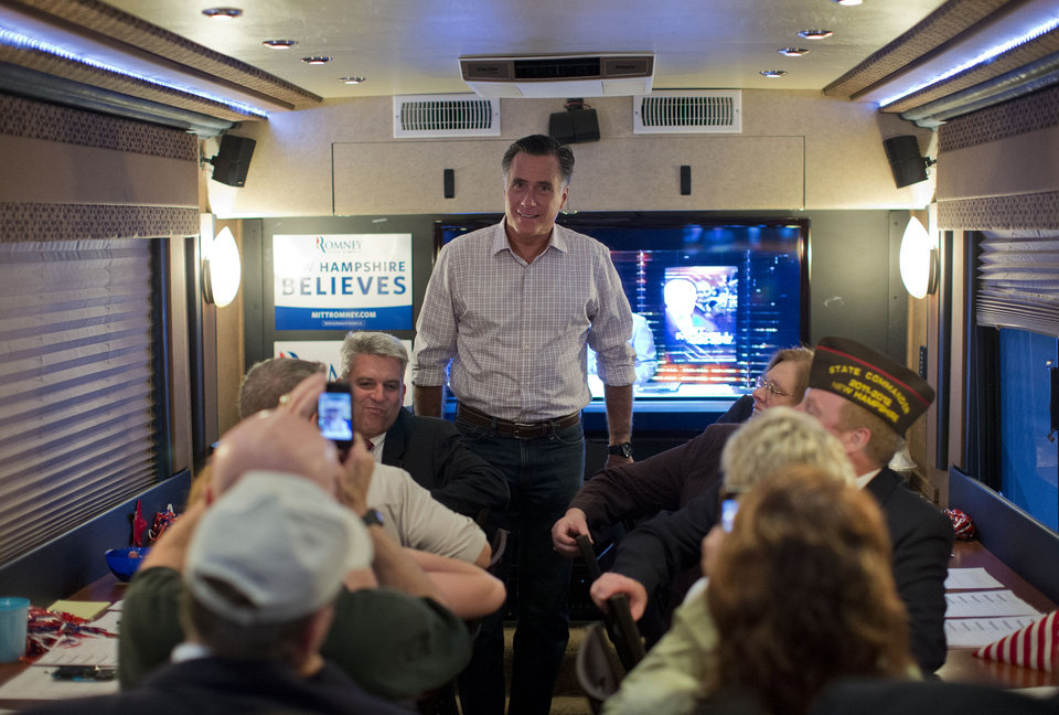 Photo -   Republican presidential candidate, former Massachusetts Gov. Mitt Romney speaks with members of the